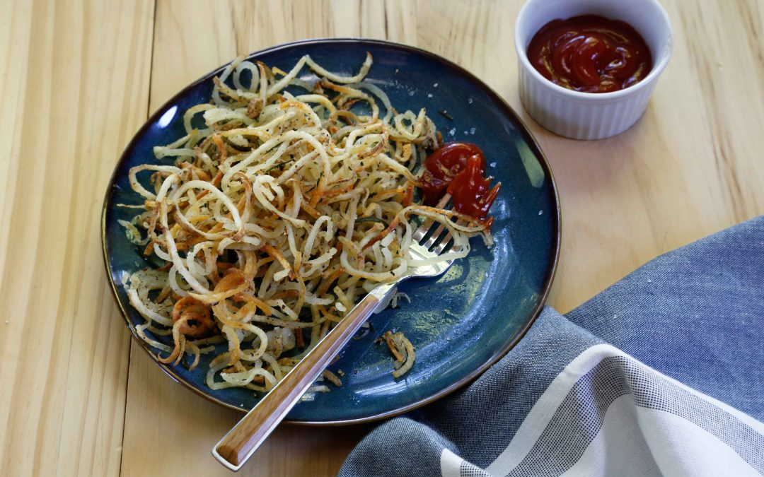 spiralized potatoes with fried rosemary